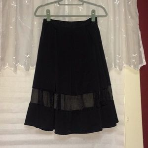 High-waisted sheer inset pleated skirt